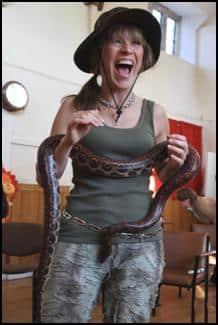 Adult handling a snake