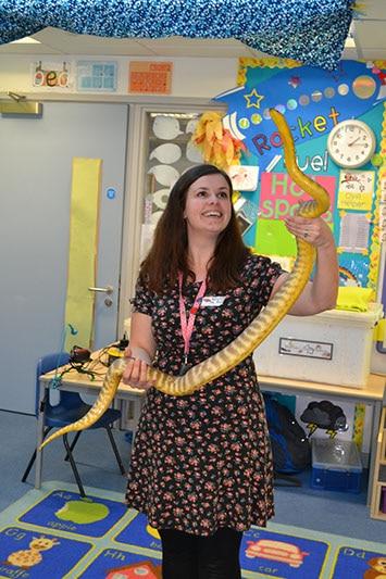 Teacher handling a snake