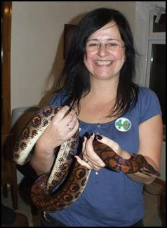 Adult holding a snake