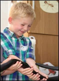 Child holding a snake